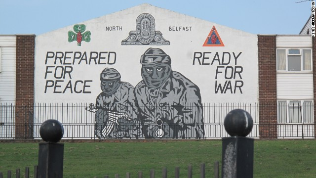 The Northern Ireland peace process was signed in 1998 but paramilitary murals -- this one for the Ulster Volunteer Force -- still cover Belfast walls.
