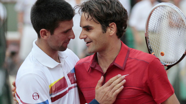 Novak Djokovic congratulates Roger Federer after the Swiss star beat him in the semifinals of the 2011 French Open.
