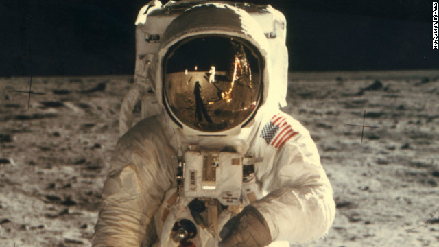 Astronaut Neil Armstrong is seen in the reflection of Edwin 'Buzz' Aldrin's helmet during the pair's historic walk on the surface of the moon on July 20, 1969.