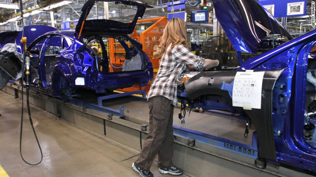 A worker builds a Ford Focus at the Ford Motor Co.'s Michigan Assembly Plant December 14, 2011 in Wayne, Michigan.