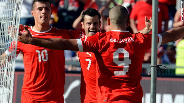 Eren Derdiyok gets the congratulations of teammates on his way to a hat-trick in Switzerland's 5-3 win over Germany.