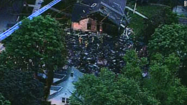 Debris lies scattered after a house in suburban Milwaukee exploded on Saturday.