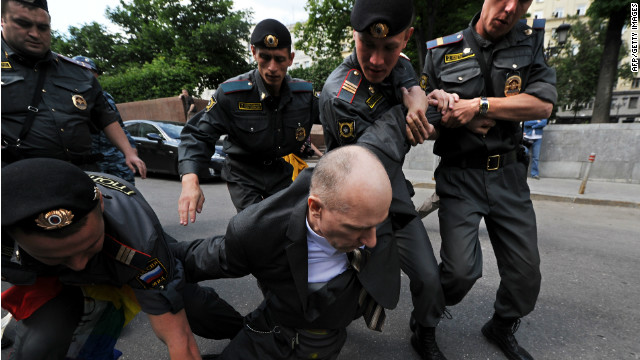 Russian police detain a man during a rally for gay rights in Moscow.