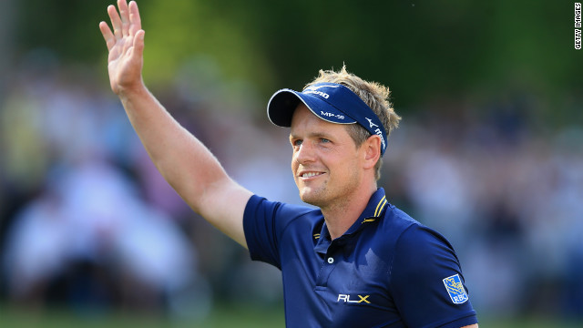 Luke Donald waves to the galleries as he completes his commanding victory at the PGA Championships at Wentworth.