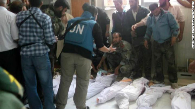 U.N. observers visit a hospital morgue in Houla on Saturday before the burial of massacre victims. Opposition activists and residents blame al-Assad's regime for the bloodbath.