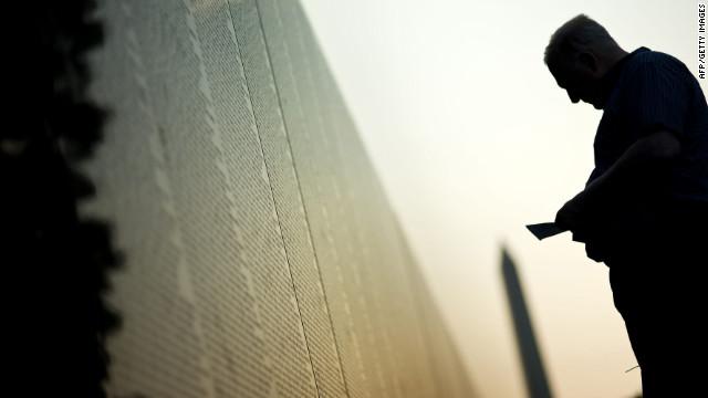 A man visits the Vietnam Veterans Memorial Wall early Monday in Washington.