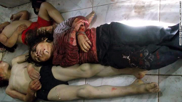 Bodies of children lie in a Houla hospital morgue before their burial Saturday in another photo from Shaam News Network. Images from the town show a room crammed with mangled and bloody bodies of children -- some with their skulls torn open.