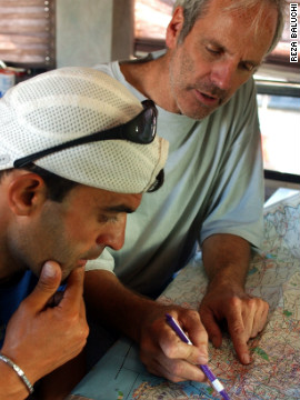 Baluchi plans his route with David Hyslop, a former businessman from Los Angeles who gave up his job to help the Iranian and become his agent.