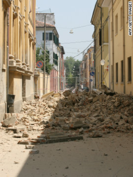 Fallen buildings fill the street in Mirandola; one of the towns closest to the quake's epicentre and an area that eyewitnesses say was most heavily damaged. 