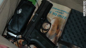 To agents\' dismay, there was also a loaded handgun -- with its hammer cocked -- found during the search of the trailer.