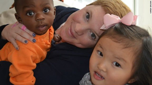 Karen Brown with her two adopted children, one-year-old Nyla from Rwanda and four-year-old Makena from China.