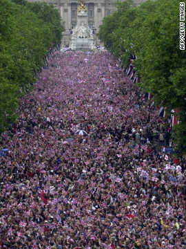 Crowds fill The Mall in central London to watch a flypast after a parade as part of the Golden Jubilee celebrations for Elizabeth II.