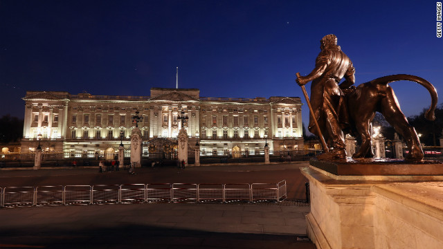 Buckingham Palace, seen from the Queen Victoria Memorial, illuminated at night. 