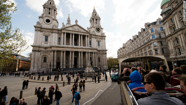 Tourists admire the view of Saint Paul's Cathedral from an open-top bus. The queen will visit the church on the morning of June 5 for the national Service of Thanksgiving before the procession and flypast at Buckingham Palace.