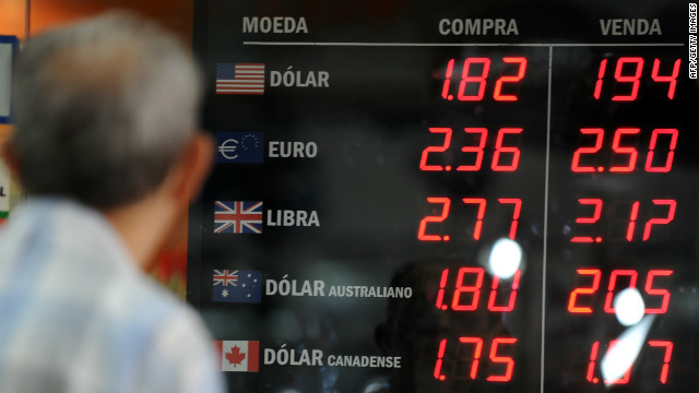 A man watches the foreign currencies exchange rate in Rio de Janeiro, Brazil.