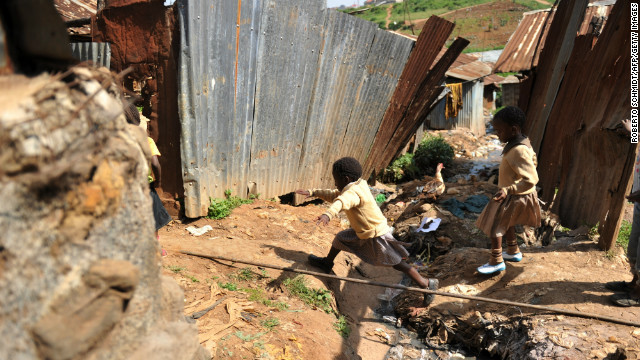 A young girl jumps across a ditch in front of her home in Kibera, the Kenyan squatter settlement that is one of Africa's biggest slums. Children raised in Kibera have no yards or suitable open spaces to play in.