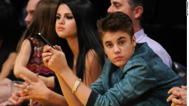 Justin Bieber and Selena Gomez watch the San Antonio Spurs play the Los Angeles Lakers in Los Angeles.
