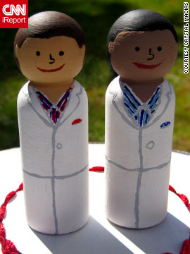 Alex and Tony wanted to keep their wedding simple and inexpensive: They made picnic lunches for guests and painted wooden dolls in their likeness for cake toppers.
