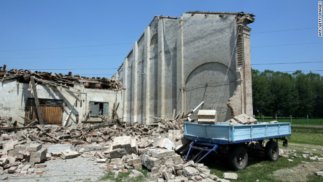 A building's roof collapsed after the earthquake in Cavezzo, Italy, where eyewitnesses say about 70% of the town was destroyed.