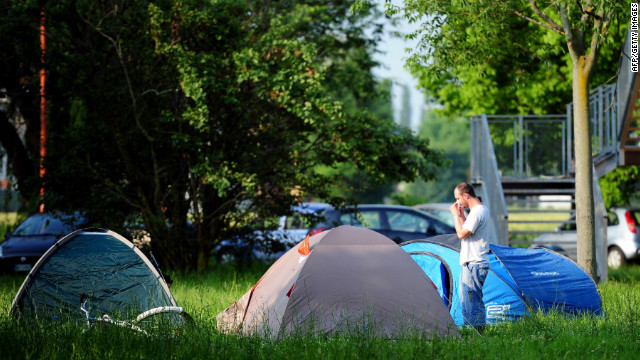 Local people wake up after sleeping in a park early on May 30, 2012 in Crevalcore. Dozens of aftershocks hit northeastern Italy overnight as thousands of jittery survivors spent the night in tents.