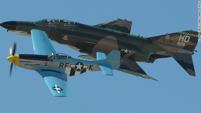 Vintage aircraft pilots perform in 2008 during <a href='http://www.dm.af.mil/index.asp' target='_blank'>Davis-Monthan's</a> annual Heritage Flight Conference. A jet-powered Vietnam War-era F-4 Phantom II flies in formation with a propeller-driven P-51 Mustang from the World War II era.