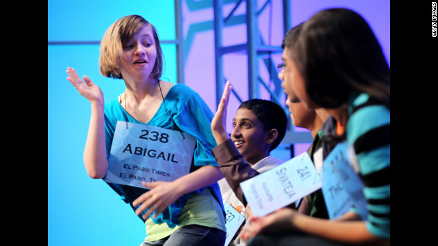 Abigail Violet Spitzer, left, of El Paso, Texas, celebrates with fellow competitors after she correctly spelled her word during the fourth round.