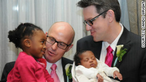 Sandis, left, and Brent Wright had their two daughters join them on their wedding day in February in Boston.