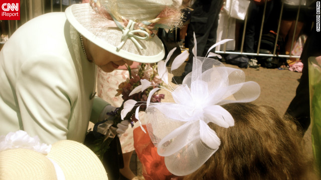 Queen Elizabeth II accepts a bouquet from nine-year-old Tatum Botha, October 24, 2011. Tatum's mom Chaleen says the meeting was a dream come true for her daughter. &quot;The Queen said, 'Thank you.' Tatum replied, 'It's a pleasure.'&quot;
