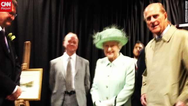Queen Elizabeth II and Prince Philip tour a college in Burnley, England on May 16, 2012. CNN iReporter Mohammed Seedat, an education ambassador who took the photo, said: &quot;She came in and talked to some of the students. I was taking snaps from the front seat when she turned and looked at me. I was quite scared, I didn't know if I was supposed to be taking photos, but in the end she seemed fine.&quot;