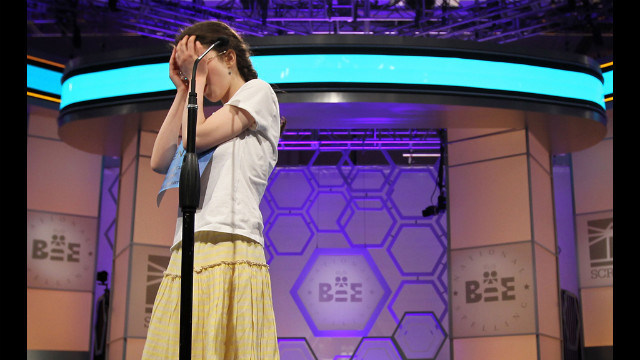 Speller Lena Greenberg of Philadelphia covers her face during round 9 of the competition after she misspelled the word &quot;geistlich.&quot; Greenberg was eliminated from the competition. 
