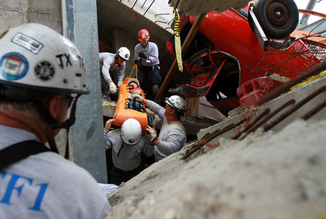 Rescue workers lift a victim out of the Disaster City parking garage.
