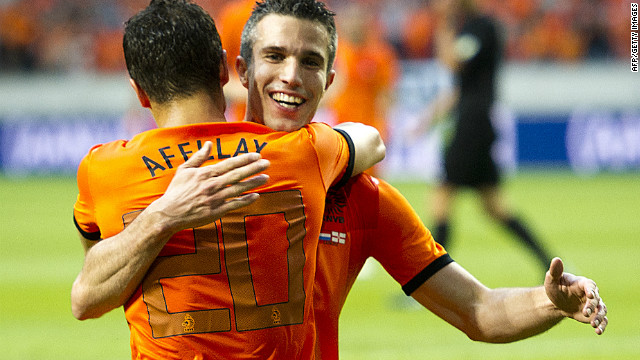Robin van Persie celebrates with Ibrahim Afellay, who also scored twice in the Netherlands' 6-0 win against Northern Ireland on Saturday.