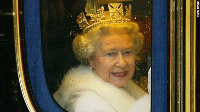 Queen Elizabeth II looks out of the window of her horse-drawn carriage as she leaves Buckingham Palace.