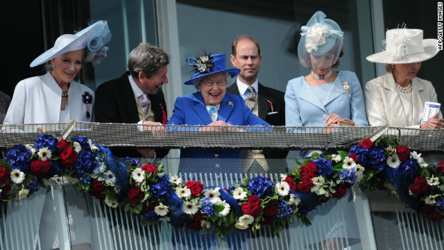 Britain's queen spends a day at the Epsom Derby marking the opening of her Diamond Jubilee weekend on June 2, 2012. Elizabeth II smiles from the royal balcony with Prince Andrew, Earl of Wessex behind her.
