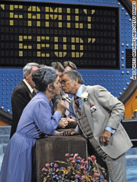 "Dawson was known for greeting female contestants with a kiss, as in this 1984 episode of ""Family Feud."""