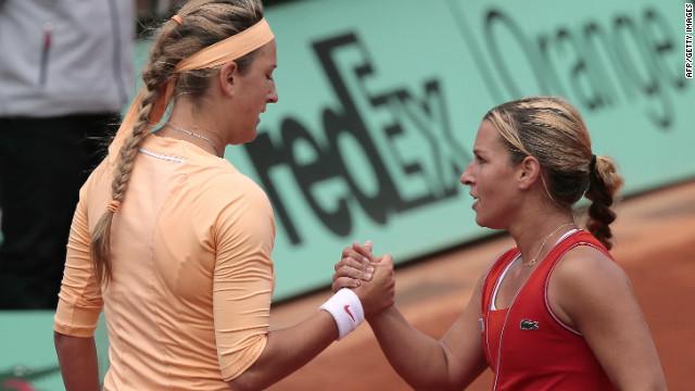 Dominika Cibulkova (R) shakes hands with Victoria Azarenka after winning their last-16 match at Roland Garros in Paris.
