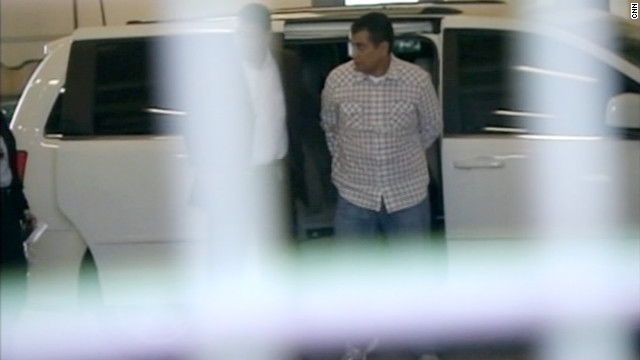 George Zimmerman is taken into Seminole County Jail after surrendering to authorities on Sunday.