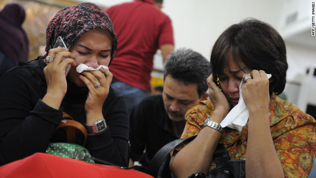 Indonesian relatives mourn at the airport in Jakarta after a Russian Sukhoi Superjet slammed into the side of a volcano on May 9, 2012. Russia's newest civilian airliner was on its second demonstration flight when the incident occured, killing all 45 people on board.