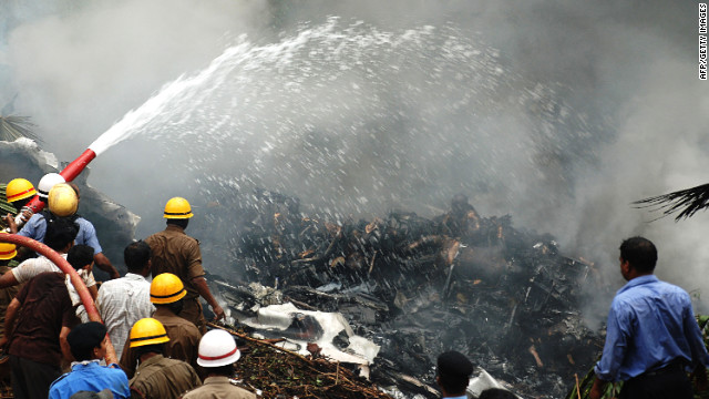 An Air India plane crash kills 158 people on May 22, 2010, after the jet overshot a runway in Mangalore, in southwestern India, crashed into a ravine and burst into flames.