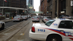 Police, firefighters and paramedics gather at Toronto\'s Eaton Centre shopping mall after reports of a shooting.