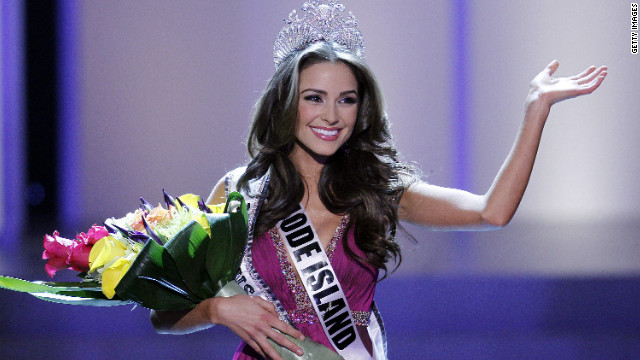 Olivia Culpo, Miss Rhode Island, waves after being crowned 2012 Miss USA.