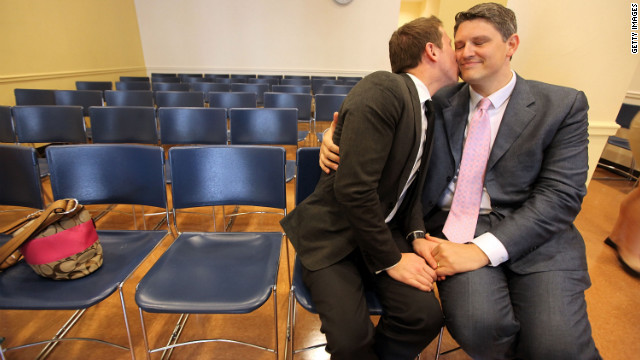 A gay couple embrace on their wedding day at the Brooklyn City Clerk's office on July 24, 2011, in New York City.