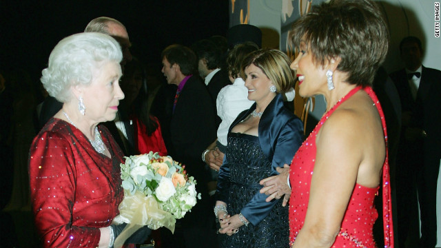 HM Queen Elizabeth II meets singer Dame Shirley Bassey backstage following the Royal Variety Performance, November 21, 2005 in Cardiff, Wales