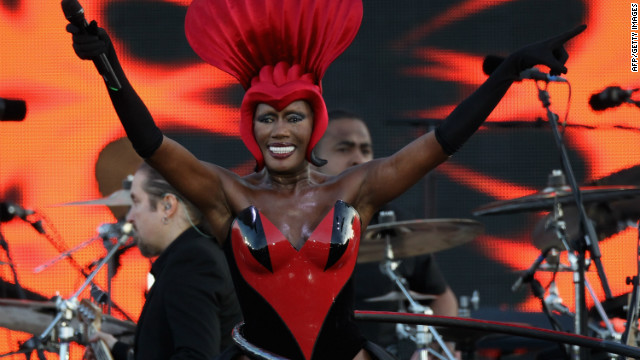Singer Grace Jones sings her hit &quot;Slave to the Rhythm&quot; while spinning a hula hoop on her hips.