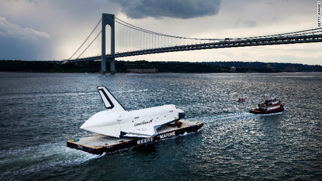 Space shuttle sails through New York Harbor