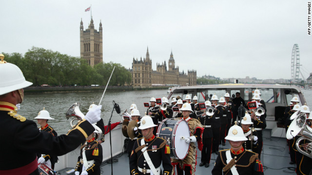 Members of Queen Elizabeth II 's Royal Marine Band, Plymouth, play in the pouring rain during the pageant, they were joined by a number of choirs and orchestras playing music along the route.