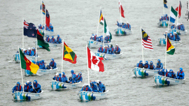 A flotilla of 55 Trinity 500's boats crewed by sea cadets from across Britain, carring the 54 Commonwealth flags, travel down the river in the pouring rain.