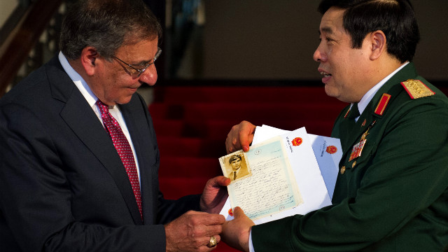 Vietnamese Minister of Defense Phuong Quang Thanh presents letters to Secretary of Defense Leon Panetta on Monday.