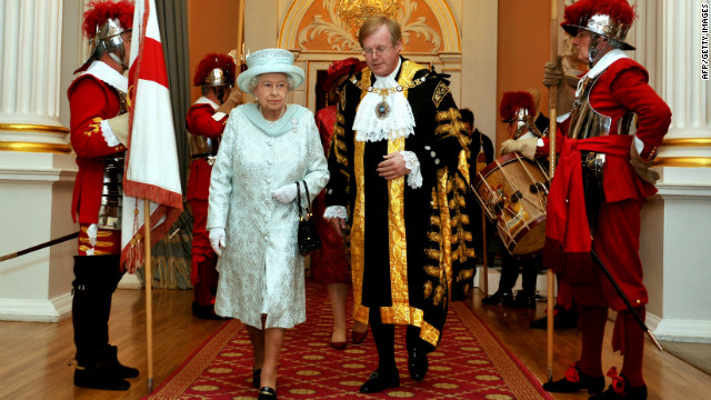 Britain's Queen Elizabeth II walks with David Wooton, the Lord Mayor of London, after arriving at Mansion House in London, in honour of her Diamond Jubilee, on June 5, 2012.