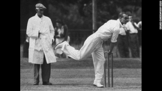 July 20, 1949: Prince Philip bowling during a village cricket match in Mersham, Kent, against the neighboring village of Aldington.